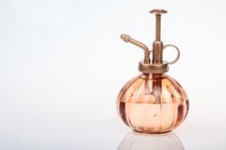 vintage perfume bottle with atomizer isolated on white background