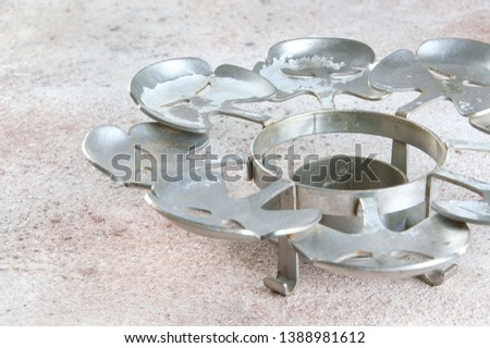 Vintage pewter candlestick coaster on a concrete background. Copy space for text. #1388981612
