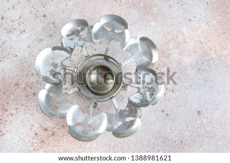Vintage pewter candlestick coaster on a concrete background. Copy space for text. #1388981621