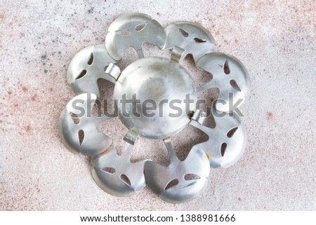 Vintage pewter candlestick coaster on a concrete background. Copy space for text. #1388981666