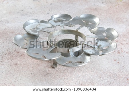 Vintage pewter candlestick coaster on a concrete background. Copy space for text. #1390836404