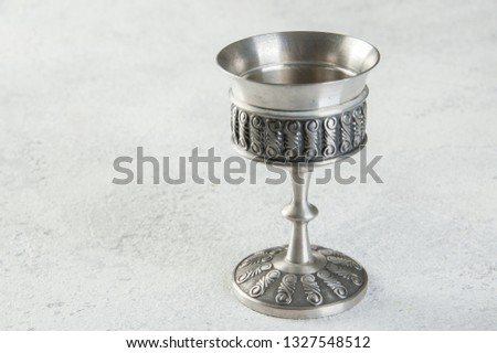 Vintage pewter goblet on concrete background. Copy space for text #1327548512