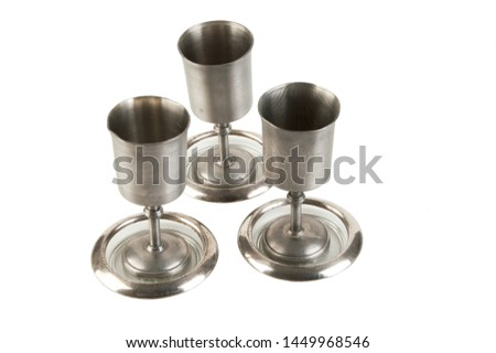 Vintage pewter goblets isolated on white background. Copy space for text #1449968546