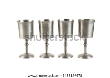 Vintage pewter goblets on white background. Copy space for text #1453129478