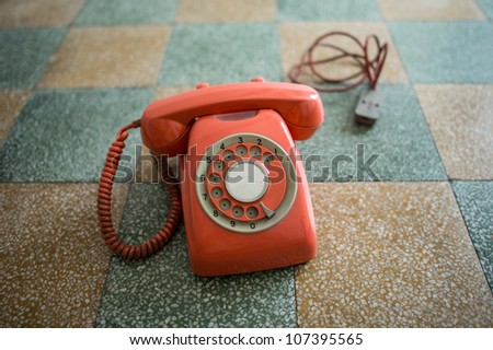 Vintage phone isolated on a floor background.