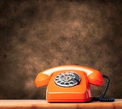 Vintage phone on a brown grunge background