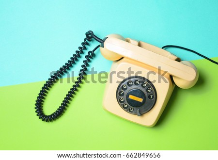 vintage phone on a green blue...