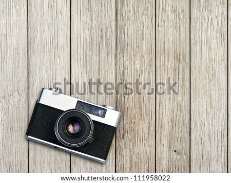 Vintage photo camera on a wooden table