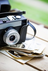 Vintage photo camera with old photo.