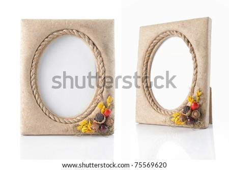 vintage photo-frame on table. isolated over white background
