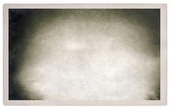 Vintage photo frame with original film grain and vignette. Used paper background