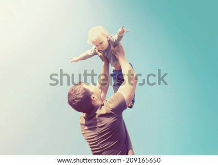 Vintage photo happy father and son having fun