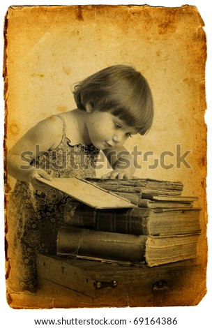 Vintage photo little girl read a old book