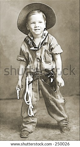 Vintage Photo of a Boy In Cowboy Outfit