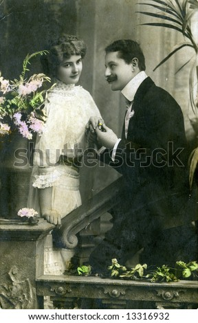 Vintage photo of a courting couple from 1900s - stock photo