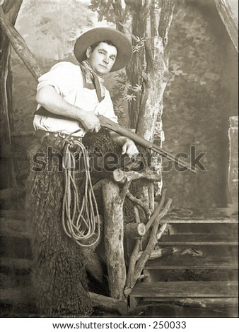 Vintage Photo of a Cowboy Holding a Rifle