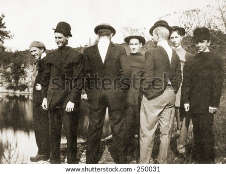 Vintage Photo of a Group of Young Men With Coats On Backwards