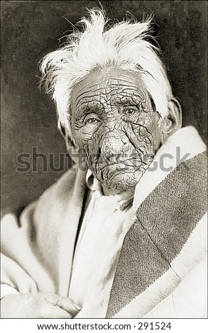 Vintage photo of a Portrait of Deeply Wrinkled Indian Man with Blanket