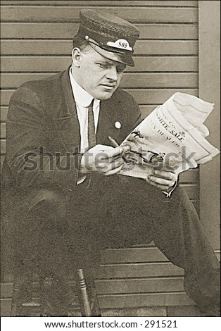Vintage photo of a Railroad Worker Reading Newspaper in Train Station