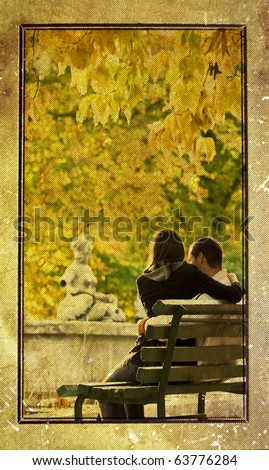 Vintage photo of a romantic couple sitting in the autumn park