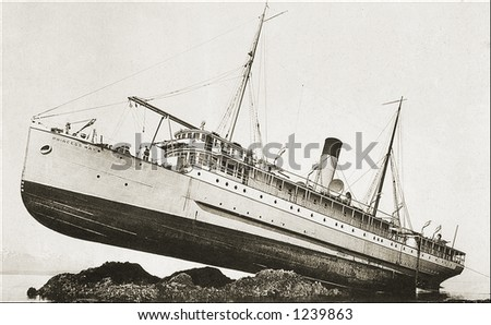 Vintage photo of a ship run aground