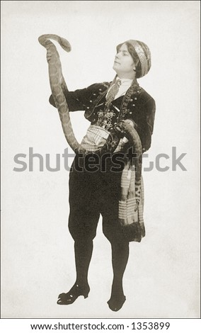 Vintage photo of a Woman Holding Up a Large Snake