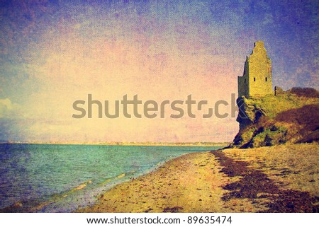 vintage photo of ancient tower ruins on the sea shore in scotland