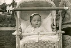 Vintage photo of baby girl in pram (fifties)
