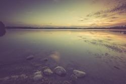 Vintage photo of beautiful lake sunset. Polish lake in Mazury lake district. Polish lake landscape