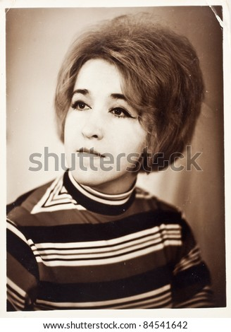 Vintage photo of beautiful young woman (circa 1960)