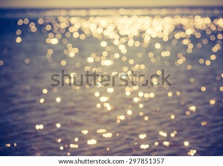 Vintage photo of blurry abstract background of defocused sea. Blurry blue landscape useful as background