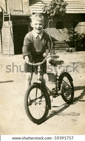 stock photo : Vintage photo of boy with bicycle (early fifties)