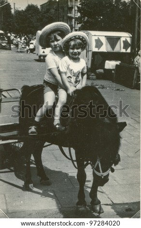 Vintage photo of brothers on pony (early eighties)