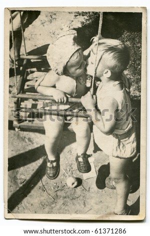 Vintage photo of children kissing