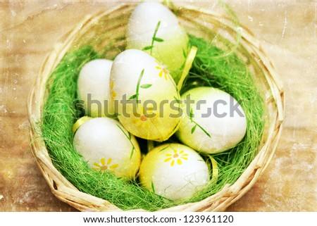 Vintage photo of Easter eggs in basket