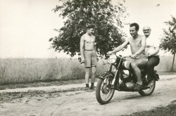 Vintage photo of elderly father and son riding a motorcycle