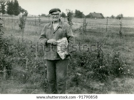 Vintage photo of elderly peasant (sixties)