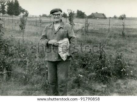 Vintage photo of elderly peasant (sixties)