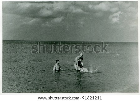 Vintage photo of family bathing in sea (fifties)