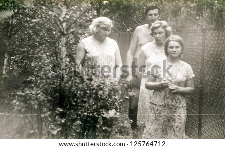 Vintage photo of family in a garden (sixties)