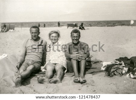 Vintage photo of family on beach (sixties)