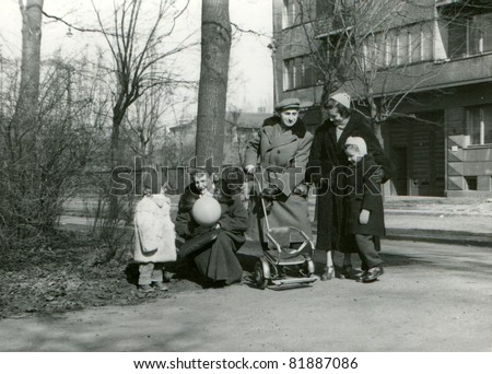Vintage photo of family walking (fifties)