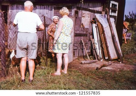 Vintage photo of farmers family (seventies) - stock photo