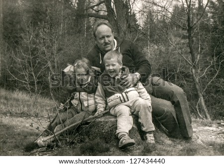 Vintage photo of father and children in forest (early eighties)