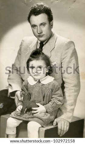 Vintage photo of father and daughter (fifties) - stock photo
