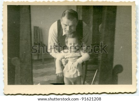 Vintage photo of father and daughter (fifties)