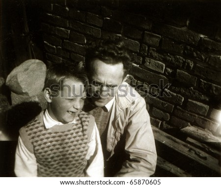 Vintage photo of father and son (fifties)
