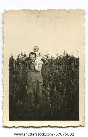 Vintage photo of father and son (forties) - stock photo