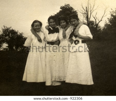 vintage photo of four young women. Circa 1910 print has scratches, fading, solarization, and soft qualities.