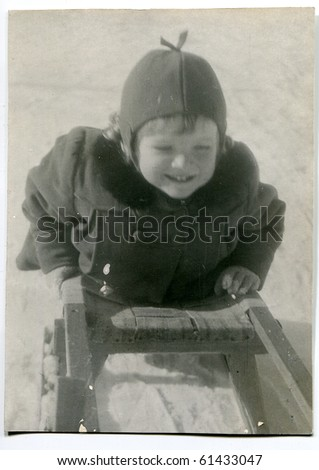 Vintage photo of girl on sled (fifties)